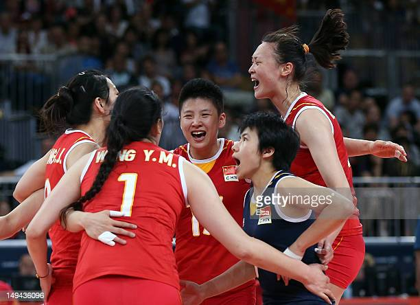 Xian Zhang and Yunwen Ma of China celebrate a point with teammates during the match against Serbia during the Women's Volleball on Day 1 of the...