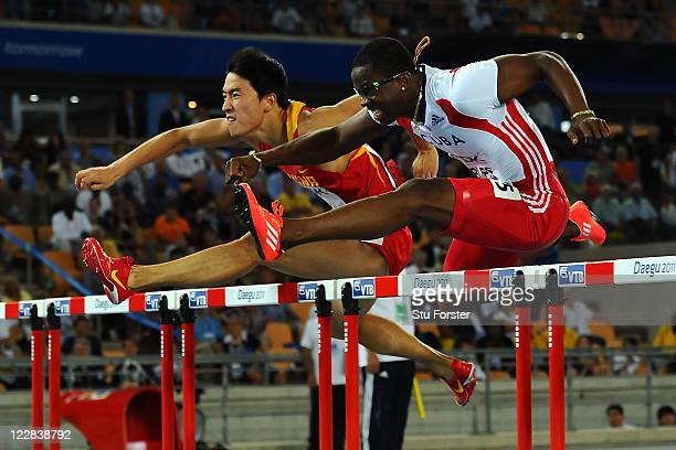 Xiang Liu of China and Dayron Robles of Cuba compete during the men's 110 metres hurdles final during day three of the 13th IAAF World Athletics...