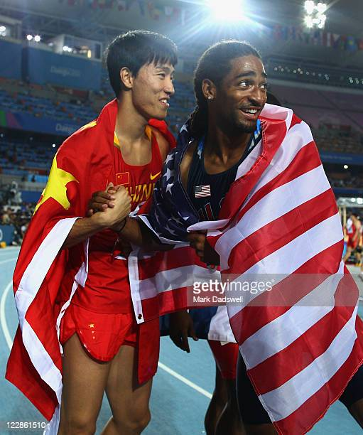 Xiang Liu of China and Jason Richardson of United States celebrate after the men's 110 metres hurdles final during day three of the 13th IAAF World...