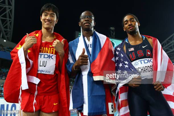 Xiang Liu of China, Dayron Robles of Cuba and Jason Richardson of United States celebrate after the men's 110 metres hurdles final during day three...