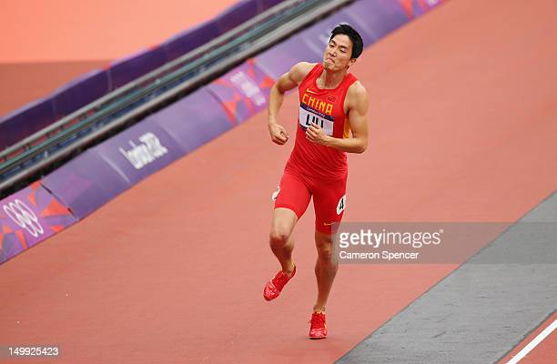 Xiang Liu of China hops on the track after getting injured in the Men's 110m Hurdles Round 1 Heats on Day 11 of the London 2012 Olympic Games at...
