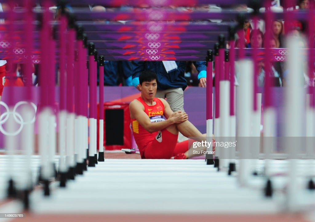 Xiang Liu of China sits on the track after getting injured in the Men's 110m Hurdles Round 1 Heats on Day 11 of the London 2012 Olympic Games at Olympic Stadium on August 7, 2012 in London, England.