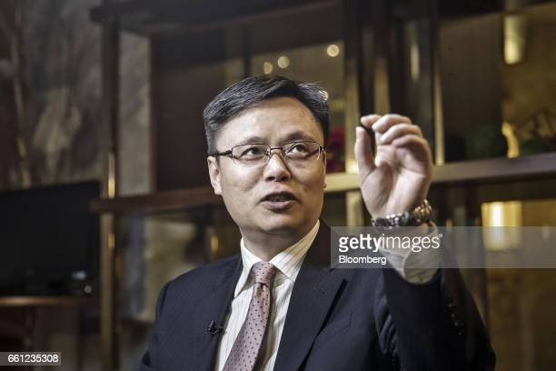 Xiao Feng chief accountant of Air China Ltd gestures as he speaks during a Bloomberg Television interview in Shanghai China on Friday March 31 2017...