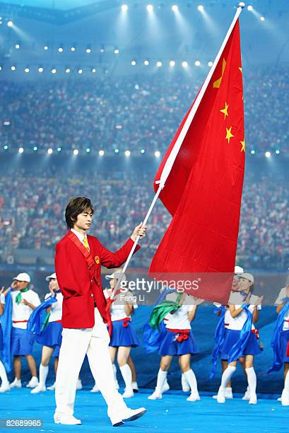 Xiao Fu Wang of China enters the stadium during the Opening Ceremony for the 2008 Paralympic Games at the National Stadium on September 6 2008 in...