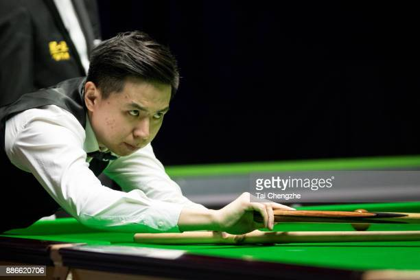 Xiao Guodong of China plays a shot during his third round match against Noppon Saengkham of Thailand on day 9 of 2017 Betway UK Championship at...