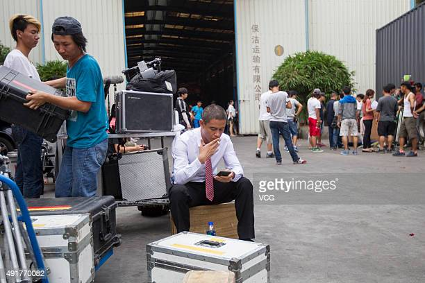 Xiao Jiguo who is famous for imitating American President Obama smokes after shooting a scene of a comedy at a warehouse on October 2 2015 in...