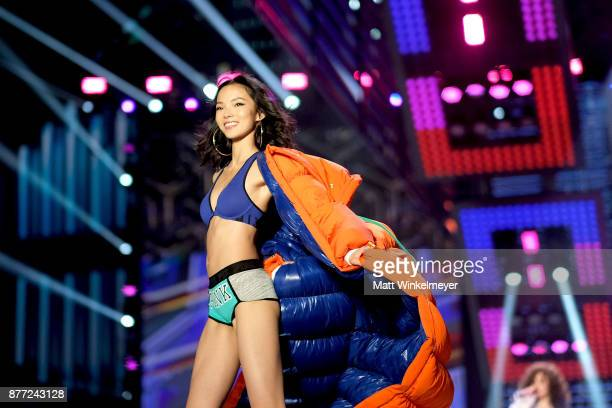 Xiao Wen Ju walks the runway during the 2017 Victoria's Secret Fashion Show In Shanghai at MercedesBenz Arena on November 20 2017 in Shanghai China
