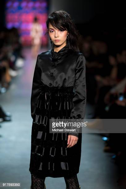 Xiao Wen Ju walks the runway during the Anna Sui fashion show during New York Fashion Week at Gallery I at Spring Studios on February 12 2018 in New...