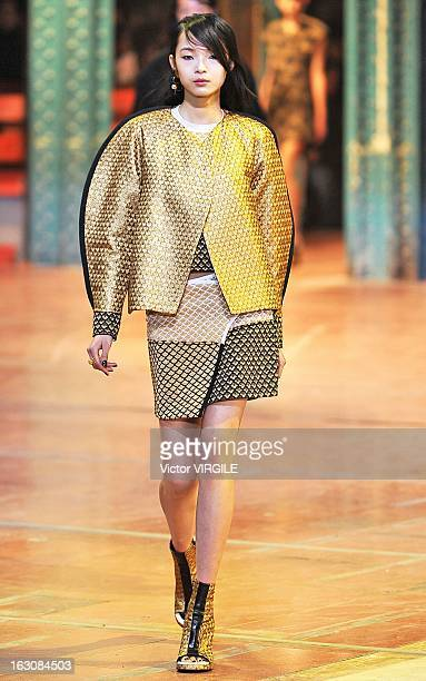 Xiao Wen Ju walks the runway during the Kenzo Fall/Winter 2013 ReadytoWear show as part of Paris Fashion Week at La Samaritaine on March 3 2013 in...