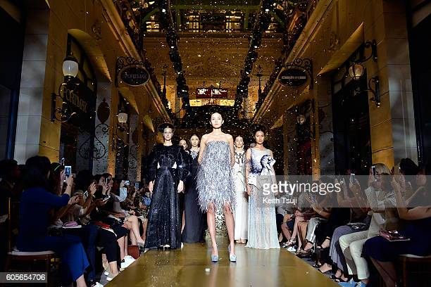 Xiao Wen walks the runway with a dress by Huishan Zhang for Swarovski during the Swarovski show during the Front Row at Shoppes at Parisian on...