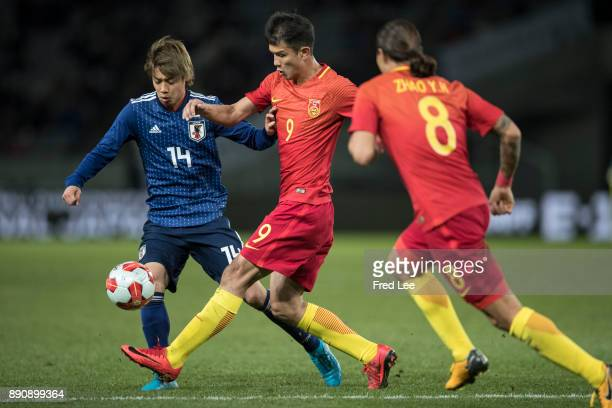Xiao zhi of china and ITO Junya of Japan in action during the EAFF E1 Men's Football Championship between Japan and China at Ajinomoto Stadium on...
