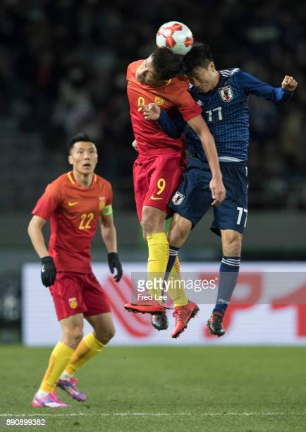Xiao zhi of china and KONNO Yasuyuki of Japan in action during the EAFF E1 Men's Football Championship between Japan and China at Ajinomoto Stadium...