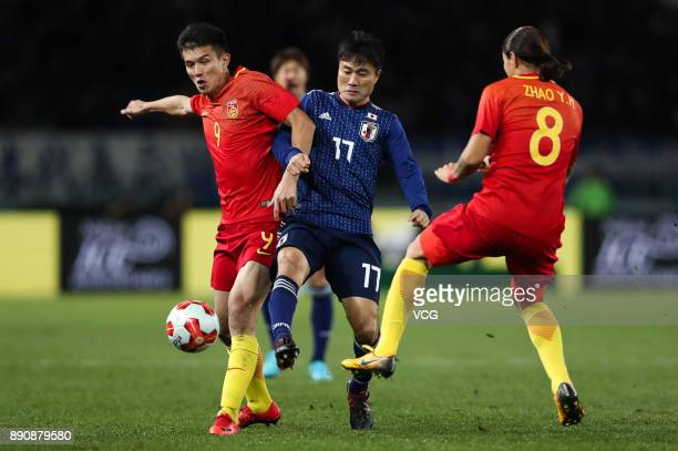 Xiao Zhi of China and Yasuyuki Konno of Japan compete for ball during the EAFF E1 Men's Football Championship between Japan and China at Ajinomoto...