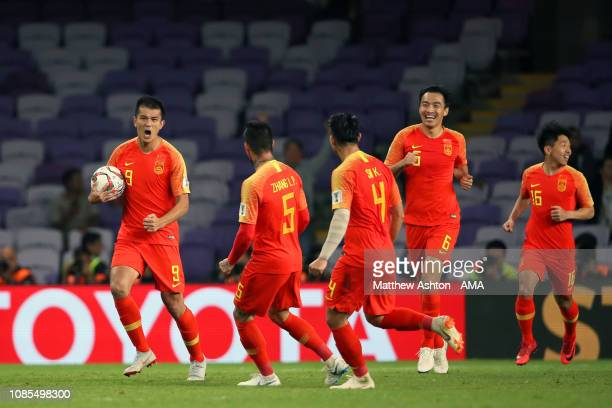 Xiao Zhi of China celebrates scoring a goal to make it 1-1 during the AFC Asian Cup round of 16 match between Thailand and China at Hazza Bin Zayed...