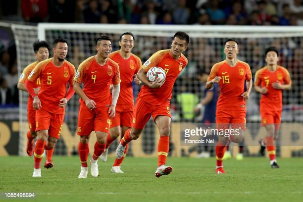 Xiao Zhi of China celebrates with his teammates after scoring his sides first goal during the AFC Asian Cup round of 16 match between Thailand and...