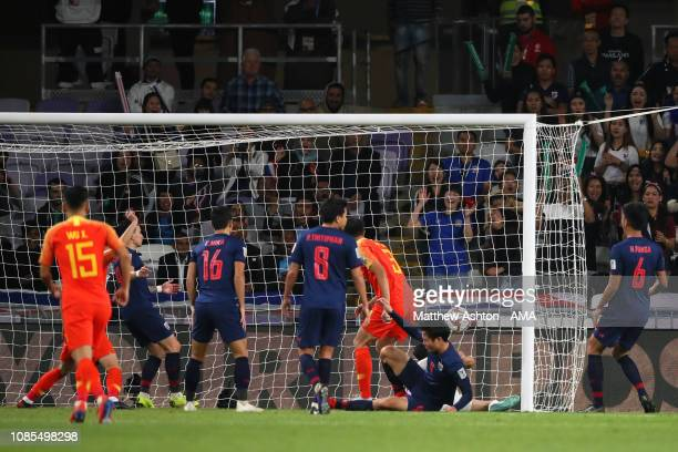 Xiao Zhi of China scores a goal to make it 1-1 during the AFC Asian Cup round of 16 match between Thailand and China at Hazza Bin Zayed Stadium on...