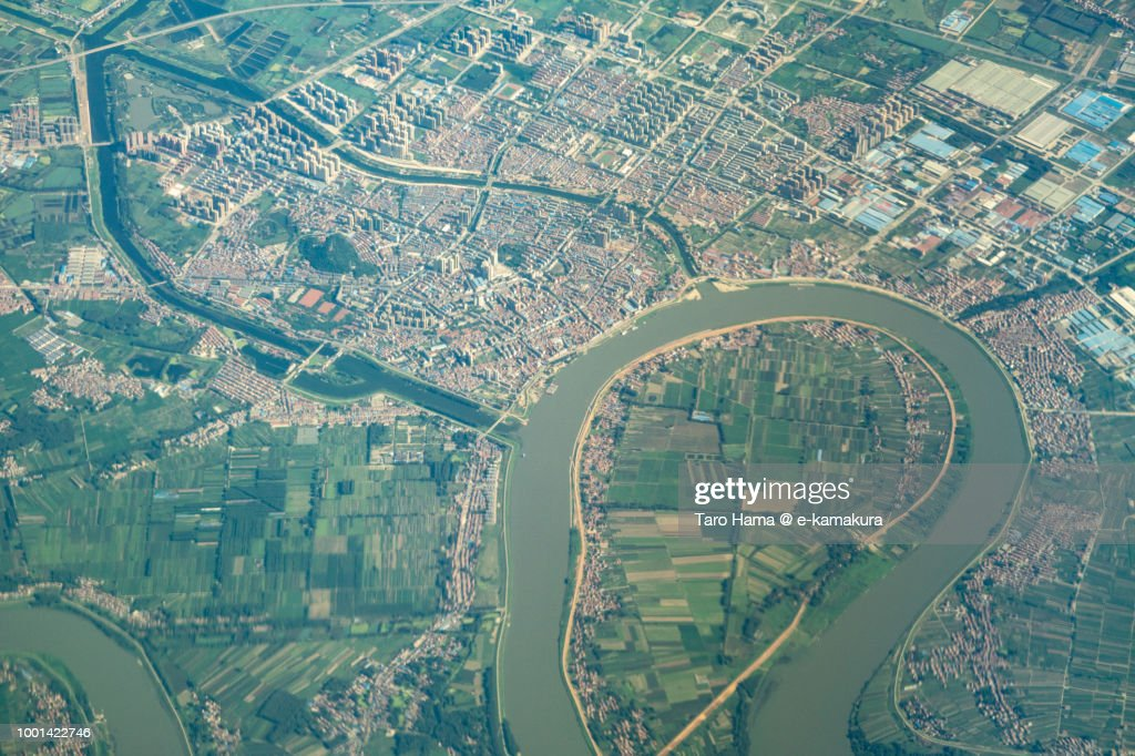 Xiaogan City in Hubei Province in China daytime aerial view from airplane : Stock Photo