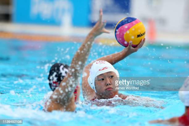 Xiaohan Mei of China looks to take a shot at the net during the 2019 FINA World League Inter-Continental Cup Woman's Bronze medal match between China...