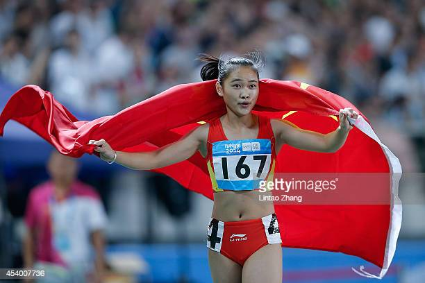 Xiaojing Liang of China celebrates after the Women's 100m Final of Nanjing 2014 Summer Youth Olympic Games at the Nanjing Olympic Sports Centre on...