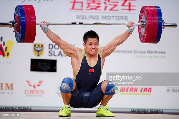 Xiaojun Lyu of China lifts in the Snatch competition men's 77 kg Group A during the weightlifting IWF World Championships Wroclaw 2013 at Centennial...