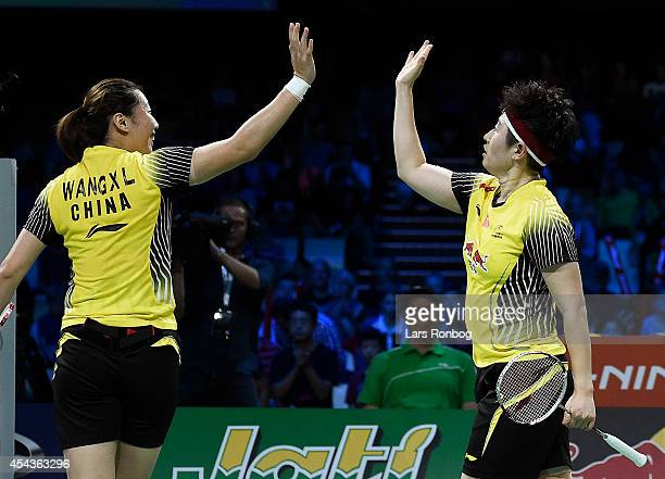 Xiaoli Wang and Yang Yu of China winning against Reika Kakiiwa and Miyuki Maeda of Japan in the semifinals during the LiNing BWF World Badminton...