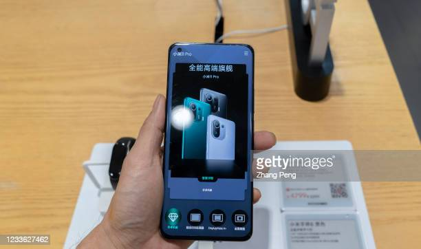 Xiaomi 11 pro' smart phone is held by a hand. The Xiaomi 11 Ultra and Xiaomi 11 pro, are the high-end products newly launched by Xiaomi early this...