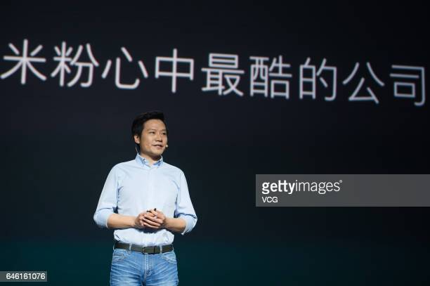 Xiaomi CEO Lei Jun introduces Surge S1 chipset Mi 5C smartphone and Redmi 4X smartphone during a press conference on February 28 2017 in Beijing...