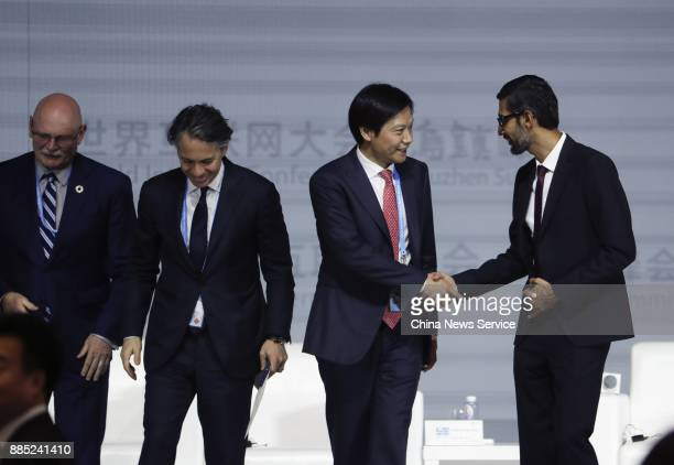 Xiaomi CEO Lei Jun shakes hands with Sundar Pichai chief executive officer of Google Inc during the 4th World Internet Conference on December 3 2017...