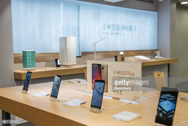 Xiaomi Corp Mi 5s Plus smartphones stand on display inside one of the company's stores in Hong Kong China on Monday June 26 2017 Smartphone...