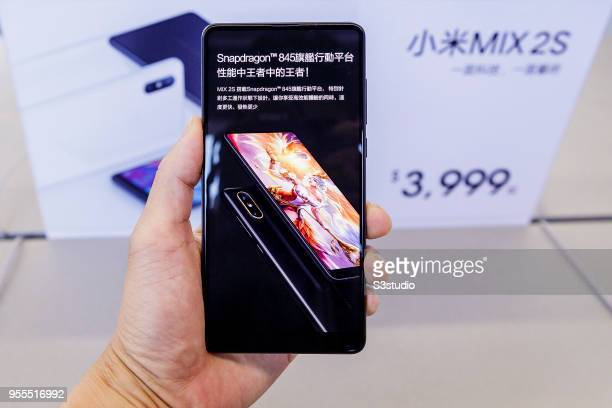 Xiaomi Corp Mi MIX 2S smartphone is displayed for a photograph inside of the Xiaomi Corp store on Nathan Road in Hong Kong on May 7 2018 in Hong Kong...