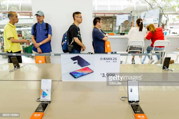Xiaomi Corp Mi MIX 2S smartphones stand on display inside of the Xiaomi Corp store on Nathan Road in Hong Kong on May 7 2018 in Hong Kong Hong Kong A...