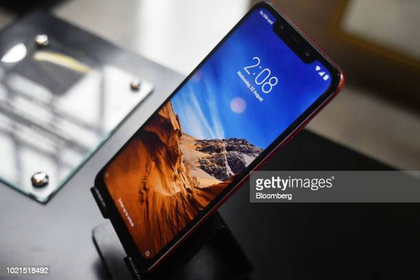 A Xiaomi Corp Poco F1 smartphone sits on display during a product launch in New Delhi India on Wednesday Aug 22 2018 Xiaomidelivered a 68 percent...