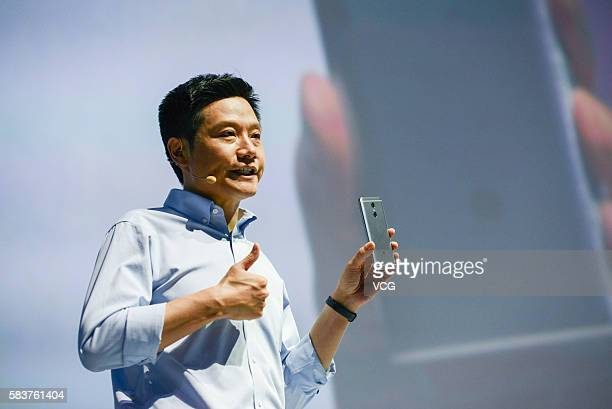 Xiaomi's CEO Lei Jun introduces Redmi Pro phone on a new products launch event as Xiaomi unveils latest dualcamera wielding Redmi Pro phone and...