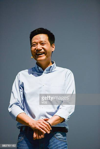 Xiaomi's CEO Lei Jun smiles on a new products launch event as Xiaomi unveils latest dualcamera wielding Redmi Pro phone and 133inch Mi Notebook Air...