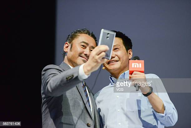 Xiaomi's CEO Lei Jun takes a selfie with actor Wu Xiubo on a new products launch event as Xiaomi unveils latest dualcamera wielding Redmi Pro phone...