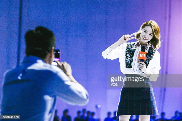 Xiaomi's CEO Lei Jun takes photos of actress Liu Shishi on a new products launch event as Xiaomi unveils latest dual-camera wielding Redmi Pro phone...