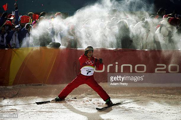 Xiaopeng Han of China celebrates after his first jump in the Mens Freestyle Skiing Aerials Final on Day 13 of the 2006 Turin Winter Olympic Games on...