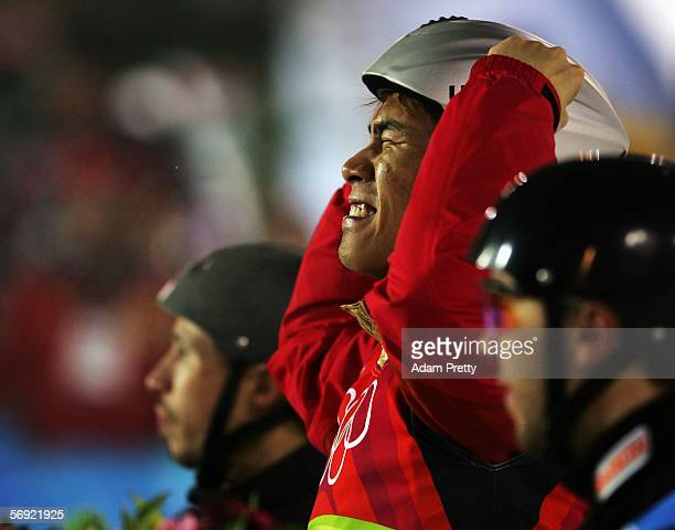 Xiaopeng Han of China celebrates winning the gold medal on the podium between silver medalist Dmitri Dashinski of Belarus and bronze medalist...