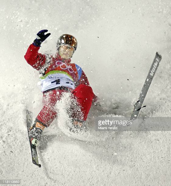 Xiaotao Ou of China loses his ski while landing on his first qualifying jump for Men's Aerials Freestyle Skiing during the 2006 Winter Olympics...