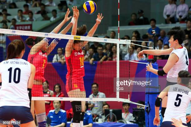 Xiaotong Liu of China defends against Heejin Kim of South Korea during the FIVB Volleyball Nations League 2018 at Beilun Gymnasium on May 17 2018 in...
