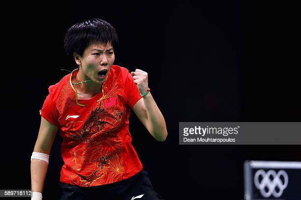 Xiaoxia Li of China celebrates a point against Tianwei Feng of Singapore during the Table Tennis Women's Team Round Semi Final between China and...