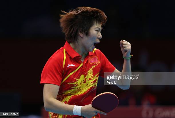 Xiaoxia Li of China celebrates a point during her Women's Singles Table Tennis Gold Medal match against Nng Ding of China on Day 5 of the London 2012...