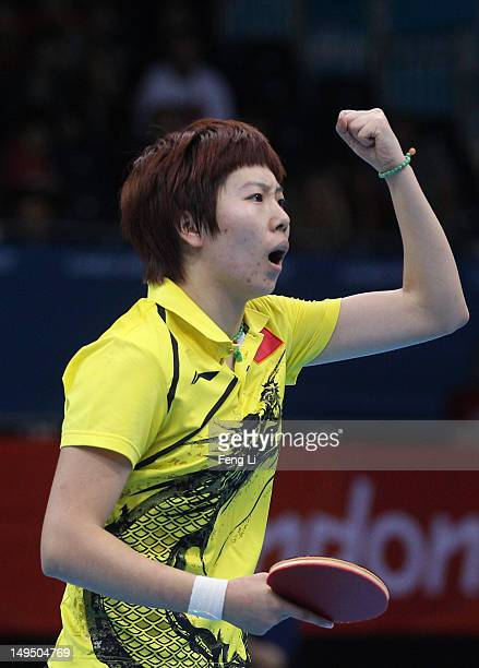 Xiaoxia Li of China celebrates winning her Women's Singles Table Tennis third round match against Ariel Hsing of the United States on Day 2 of the...