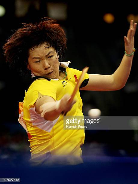 Xiaoxia Li of China competes against Kung Ah Kim of South Korea in the Table Tennis Women's Singles Semifinals at Guangzhou Gymnasium during day...