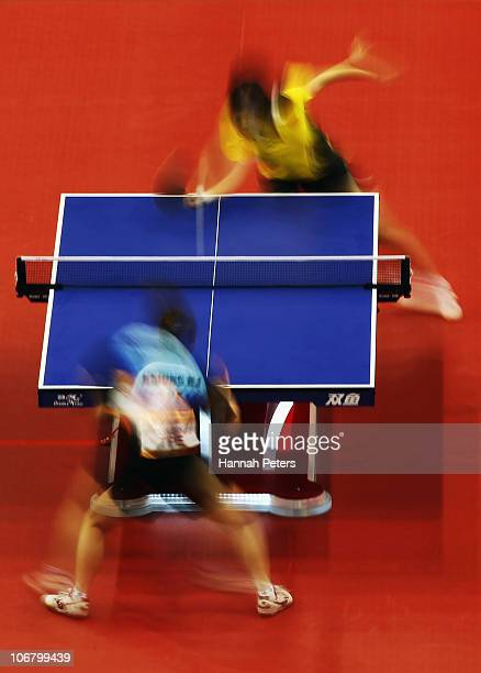 Xiaoxia Li of China competes against NaiI Hsiung of Chinese Taipei in the Women's Team contest at the Gyangzhou Gymnasium during day one of the 16th...