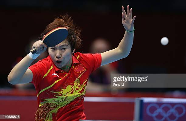 Xiaoxia Li of China competes during her Women's Singles Table Tennis Gold Medal match against Ning Ding of China on Day 5 of the London 2012 Olympic...