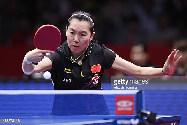 Xiaoxia Li of China plays a backhand against Kasumi Ishikawa of Japan during day eight of the 2014 World Team Table Tennis Championships at Yoyogi...