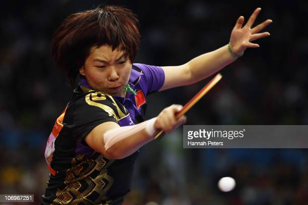 Xiaoxia Li of China plays a forehand in the Women's Doubles Final with Yue Guo of China against Ning Ding and Shiwen Liu of China at Guangzhou...