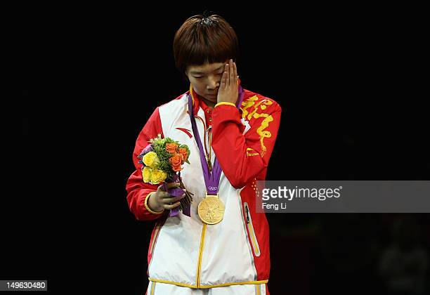 Xiaoxia Li of China reacts on the podium after winning the Gold medal in the Women's Singles Table Tennis Gold Medal match against Ning Ding of China...