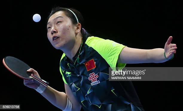 Xiaoxia Li of China serves to Tianwei Feng of Singapore during their women's singles semi final table tennis match in the ITTF Nakheel Table Tennis...